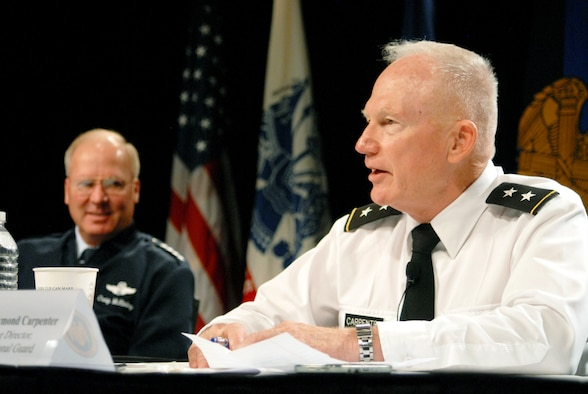 Army Maj. Gen. Raymond Carpenter (right), the acting director of the Army National Guard, and Air Force Gen. Craig R. McKinley, the chief of the National Guard Bureau, along with other Guard leaders answered questions from the audience Aug. 2, 2010, during a panel discussion at the 2010 National Guard Volunteer Workshop in New Orleans.  More than 1,000 Guard volunteers from the 54 states and territories attended the conference. (U.S. Army photo by Sgt. Darron Salzer)