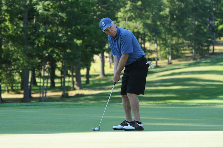 NH Air National Guard Colonel (retired) Thomas Bunting lines up to putt during the 46th Annual NH National Guard Golf Classic 2010 tournament held at The Oaks Golf Links, Somersworth, NH, July 26, 2010. (released/photo by Aaron Vezeau)