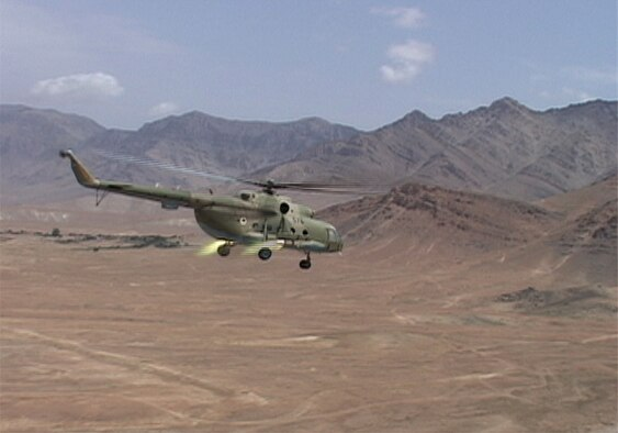 Afghan Air Force Mi-17 performs the first live fire training at the Kabul Military Training Center in Kabul on August 1, 2010 (U.S. Navy photo by Mass Communications Specialist First Class Elizabeth Burke/RELEASED).