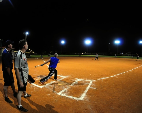 ANDERSEN AIR FORCE BASE, Guam - A member of the 36th Security Forces Squadron's intramural softball team hits a fly-ball during the base intramural softball championship between the 36th SFS and 36th Logistical Readiness Squadron here Aug 2. The game was an offensive shoot-out with several homeruns and runs scored. The final tally was 19-16 with the 36th SFS team walking away the victors. (U.S Air Force photo by Airman Julian North)