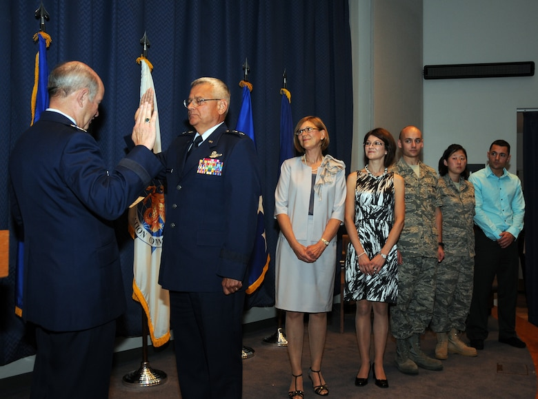 General Duncan McNabb, Commander, United States Transportation Command  administers the Officers Oath to newly promoted Maj. Gen. James Kwiatkowski, as the major general's family looks on. (Front to back) his wife Ranea Kwiatkowski, his daughter Nichole Dabby, his son 107th AW member Tech. Sgt. Andrew Kwiatkowski, his daughter 107th AW member Airman 1st Class Laura Kwiatkowski and his son Kevin Kwiatkowski. (U.S. Air Force photo/Staff Sgt. Peter Dean)