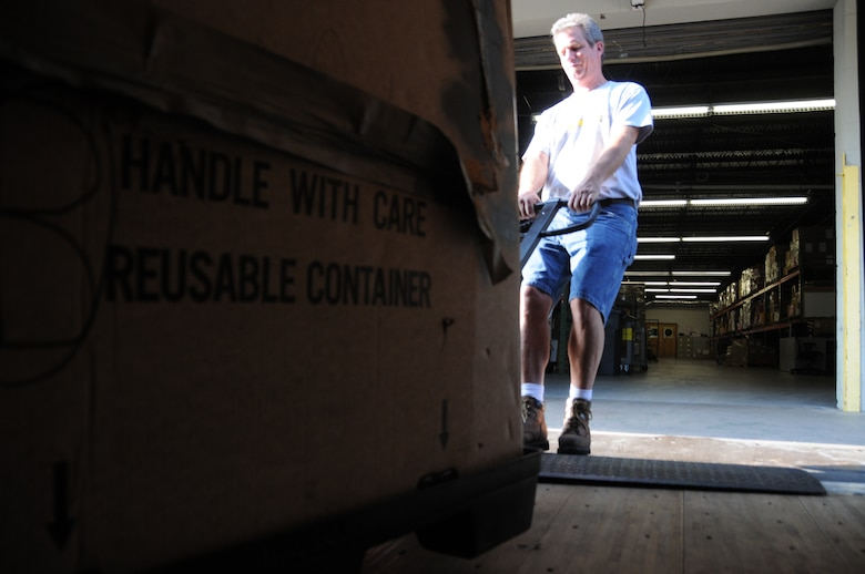 Charlotte, NC. -- Michael Daley offloads a crate of donated school supplies from a NC National Guard truck. Daley, the warehouse coordinator of Classroom Central, a non-profit organization created to to provide free supplies to the children of the Charlotte-Mecklenburg School system. The NC National Guard Counter Drug Task Force is directly helping the with the non-profit and several businesses in the Charlotte area by participating in School Tools, a campaign to collect school supplies for needy children.  Photo by Tech. Sgt. Brian E. Christiansen.