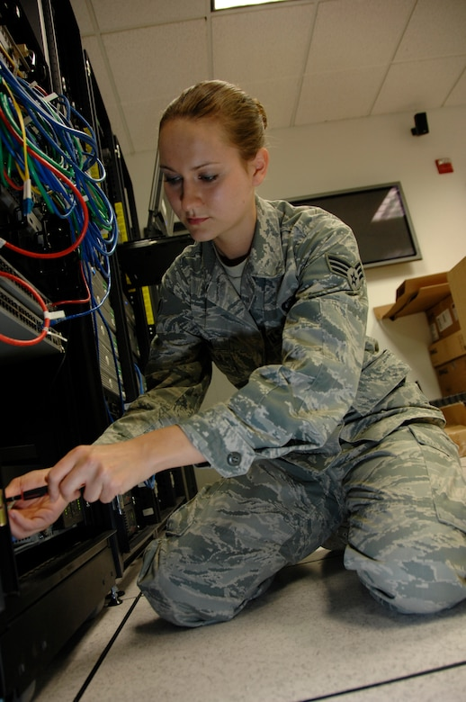 Senior Airman Holly Durkin, a Cyber Surety Technician for the 129th Communications Flight, Moffett Federal Airfield, Calif., replaces an uninteruptable power supply (UPS) from a network server, August 4, 2010.  The UPS serves as back-up power supply for network servers in case of main power loss. (Air National Guard photo by Tech. Sgt. Ray Aquino)