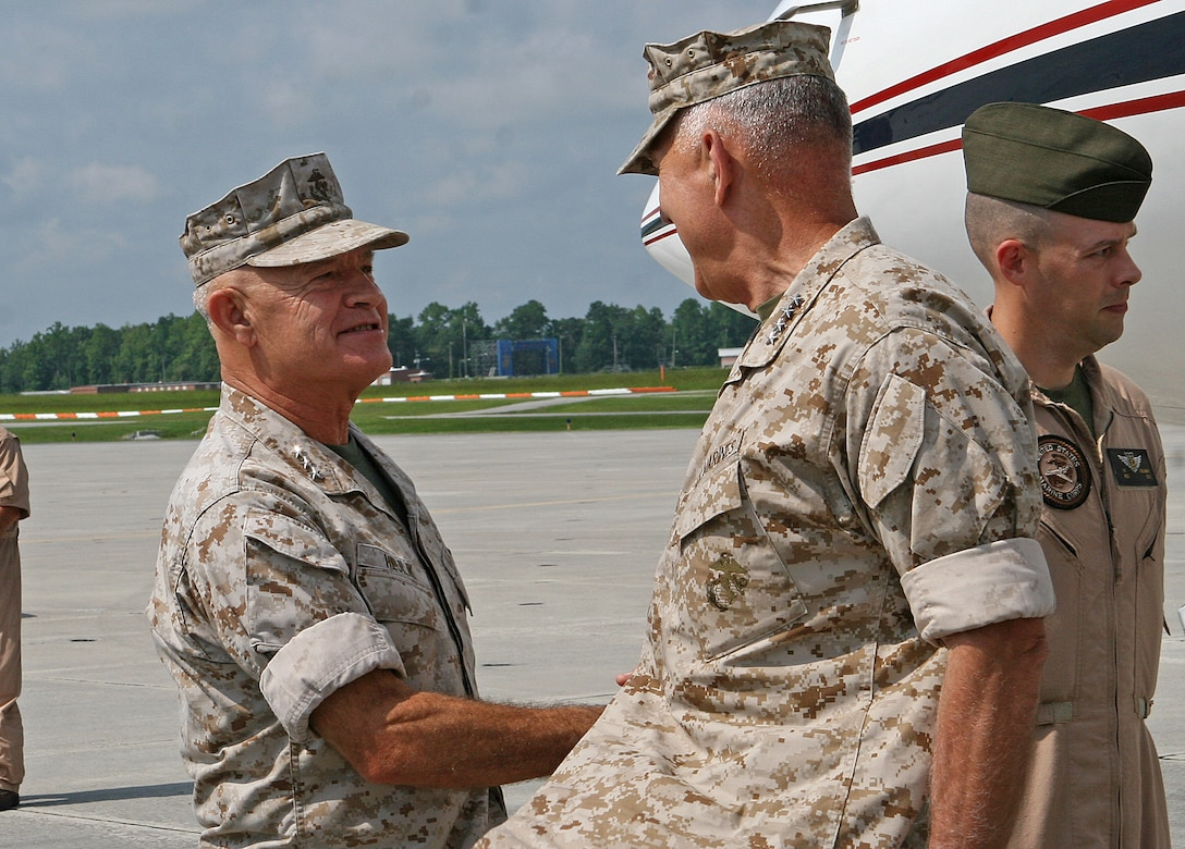 Lt. Gen. Dennis J. Hejlik (left), commanding general of II Marine Expeditionary Force, greets Gen. James T. Conway, Commandant of the Marine Corps, as he arrives aboard Marine Corps Air Station New River, N.C., Aug. 5, 2010. Conway, accompanied by Sgt. Maj. Carlton W. Kent, Sergeant Major of the Marine Corps, toured Marine Corps bases and air stations along the East Coast Aug. 4-6, and took the opportunity to hold town hall-style meetings with the Marines and sailors stationed there.
