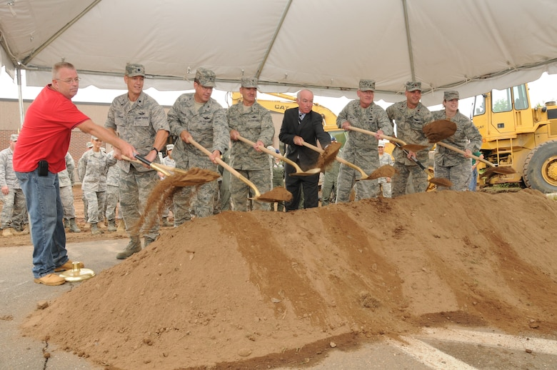 Mr. Scott Pearsall, Lt. Col. Aaron Lehman, commander, 609th Detachment, Col. Peter J. DePatie, commander, 103rd AOG, Brig. Gen. Daniel Peabody, Assist Adjutant for Air, Mr. Joe Courtney, U.S. Representative of the 2nd Congressional District, Maj. Gen. Thad Martin, The Adjutant General, Maj. Robert Feher, and Master Sgt. Heather Kirkham take part in the AOG's ceremonial groundbreaking  Aug. 5, 2010, on base. (U.S. Air Force photo by Tech. Sgt. Erin McNamara)