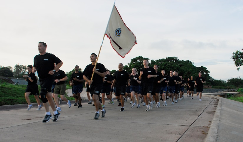 SOTO CANO AIR BASE, Honduras --  Members of Joint Task Force-Bravo's Army Forces close in on the finish line during the JTF-Bravo Run here Aug. 6. The monthly run encourages esprit de corps and fitness. (U.S. Air Force photo/Tech. Sgt. Benjamin Rojek)
