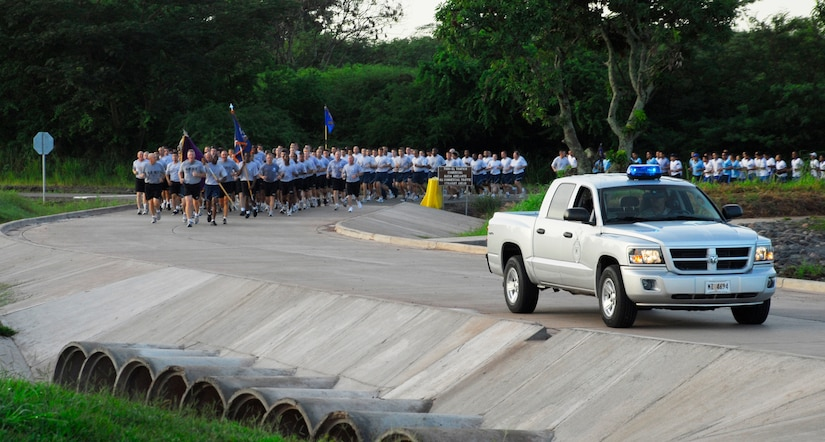 SOTO CANO AIR BASE, Honduras --  Joint Security Forces members escort Joint Task Force-Bravo as they participate in the JTF-Bravo Run here Aug. 6. The group is followed up by an ambulance to ensure the safety of the runners. (U.S. Air Force photo/Tech. Sgt. Benjamin Rojek)