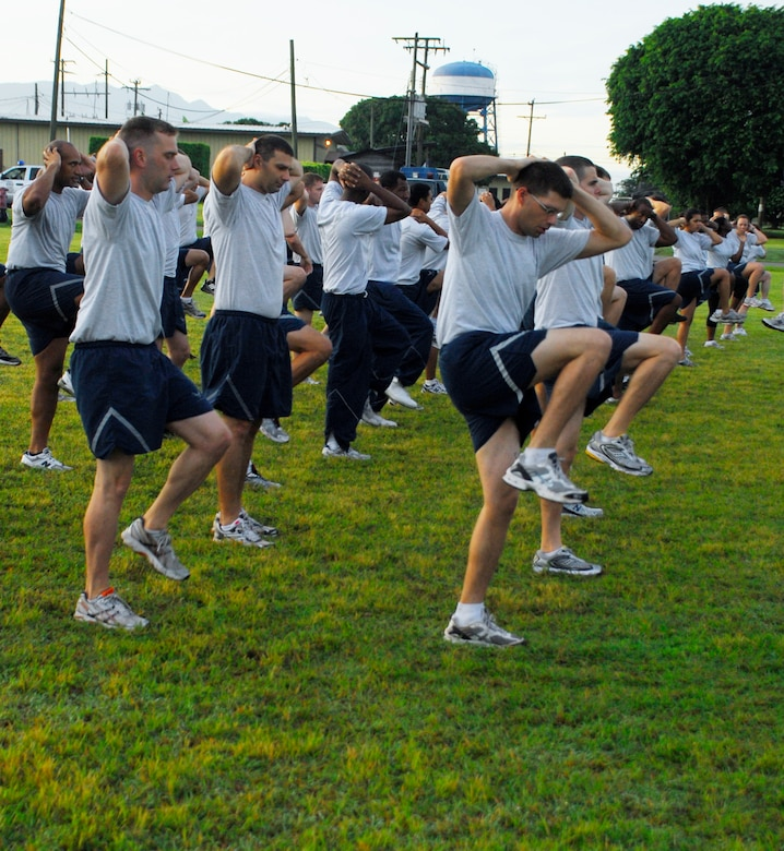 SOTO CANO AIR BASE, Honduras --  Members of the 612th Air Base Squadron perform warm-up exercises before the Joint Task Force-Bravo Run here Aug. 6. The monthly run encourages esprit de corps and fitness. (U.S. Air Force photo/Tech. Sgt. Benjamin Rojek)
