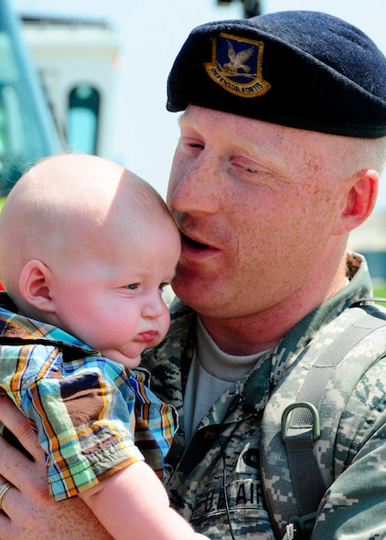 Master Sgt. Stan Drozdowski holds his son Talon Drozdowski for the very first time after returning from a six-month deployment to Iraq.  Drozdowski is a member of the 134 ARW Security Forces Squadron at McGhee Tyson Air National Guard Base, Tennessee.  (US Air Force photo by Tech. Sgt. Kendra M Owenby, 134 ARW Public Affairs)