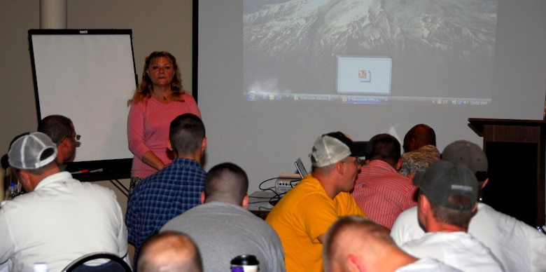 Dr. Mary Sullivan speaks with members of the 148th Fighter Wing Security Forces Squadron on the importance of mental and physical health during a 60-day Yellow Ribbon Reintegration Program event in Duluth, Minn. On Aug. 8, 2010.