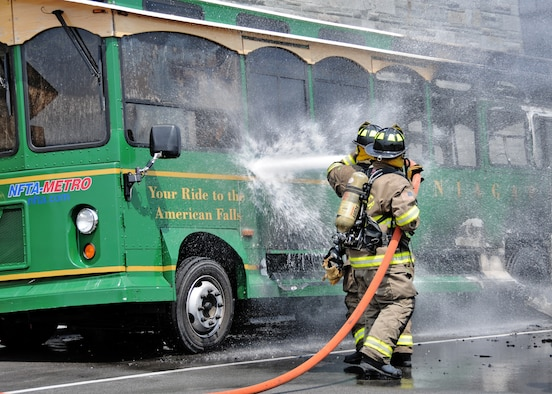 The Niagara Falls Air Reserve Station responded to a fire at the Niagara Falls international Airport on August 2, 2010, Niagara Falls NY. According to reports, one of its replica vintage trolleys caught fire right outside the airport. The trolley was unoccupied during the incident. (U.S. Air Force photo by Staff Sgt. Joseph McKee)