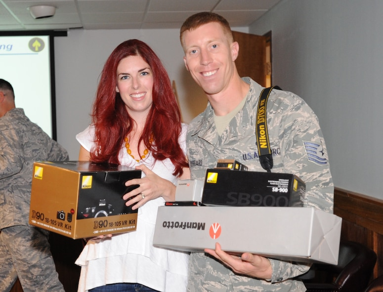 Andrea Hubbard, winner of the Year of the Air Force Family Original Photography competition and spouse of U.S. Air Force Tech Sgt. Daniel Hubbard, 27th Special Operations Civil Engineer Squadron, received a Nikon D90 camera package, an SB-900 Flash, a Manfrotto Tripod, a SanDisk 4GB Card and a battery charger.Her winning photo will appear in the Year of the Air Force Family Gallery at the Pentagon. (U.S. Air Force photo by Airman 1st Class Maynelinne De La Cruz)