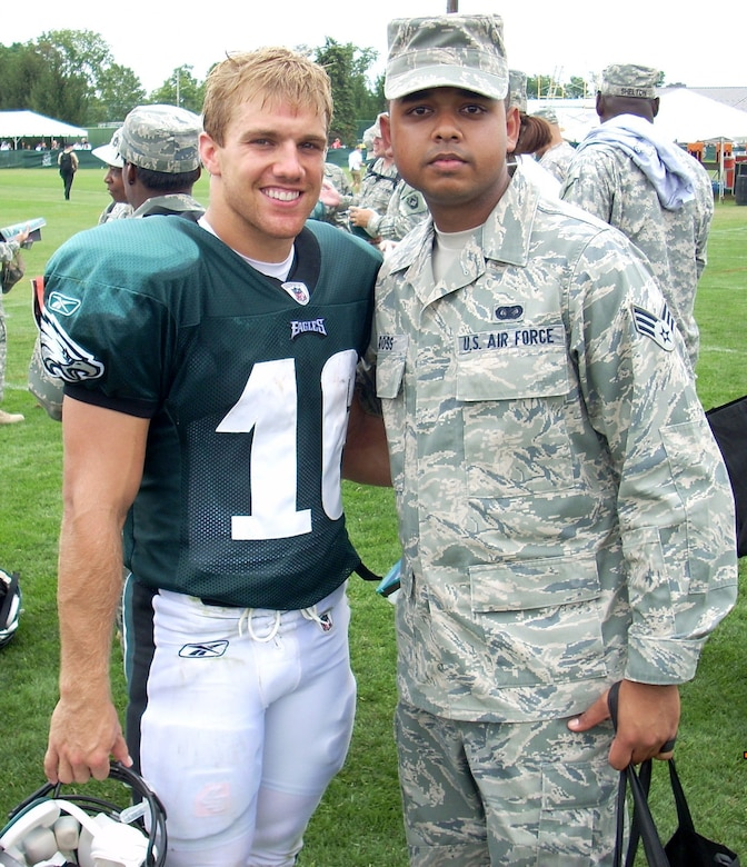 LEHIGH, Pa.,- Senior Airman Moses Ross, 512th Mission Support Squadron knowledge operations manager out of Dover Air Force Base, Del., poses with Philadelphia Eagles' wide receiver, Chad Hall at the Eagles' training camp, Aug. 3. The Eagle's organization, along with the USO, holds this event once a year, where the organization's members and players honor servicemembers from the Philadelphia area. Hall graduated from the U.S. Air Force Academy in 2008. (U.S. Air Force photo/Senior Master Sgt. James Mcgarvey)