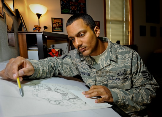 "MINOT AIR FORCE BASE, N.D. -- Staff Sgt. Eric Henson, 5th Force Support Squadron base personnel reliability program monitor, works on a sketch of Marvel comics ""Spiderman"" in his home here Aug. 11. Sergeant Henson has been a comic artist since he was five years old when his father gave him a ""Silver Surfer"" comic book. (U.S. Air Force photo by Senior Airman Benjamin Stratton)"