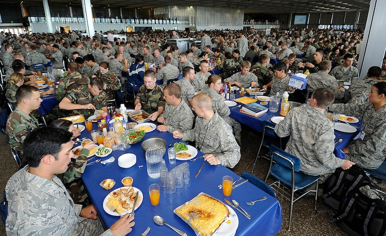 Cadets eat lunch at Mitchell Hall Aug. 10, 2010, during the first full week of the 2010-2011 school year at the Air Force Academy in Colorado Springs, Colo. The staff at Mitchell Hall serves 4,000 meals for the Cadet Wing three times per day. (U.S. Air Force photo/Rachel Boettcher)
