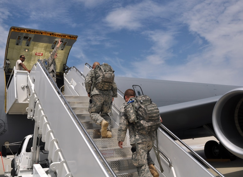 Staff Sgt. Scott Frazer, a 128th Air Refueling Wing security forces team member, waves good-bye to his wife and three children as he boards a KC-135R Stratotanker on Tuesday, August 10, 2010.  Frazer, along with 12 other security forces Airmen, deployed to Southwest Asia to provide base security in support of Operation Enduring Freedom.  (U.S. Air Force photo by Senior Airman Ryan Kuntze / released)