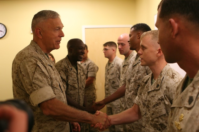 Gen. James T. Conway and Sgt. Maj. Carlton W. Kent present challenge coins to Marines and Sailors of U.S. Marine Corps Forces, Special Operations Command. Conway and Kent thanked MARSOC Marines and Sailors for their service and dedication.