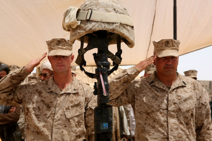 Lt. Col. Kyle B. Ellison, left, commanding officer of 2nd Battalion, 6th Marine Regiment, and Sgt. Maj. William Frye, sergeant major of 2/6, salute the memorial stand of Lance Cpl. Abram L. Howard during a memorial service at the Marjah District government center in Marjah, Afghanistan, Aug. 12, 2010. Howard, from Williamsport, Pa., was killed July 27 while conducting combat operations in Helmand province, Afghanistan.