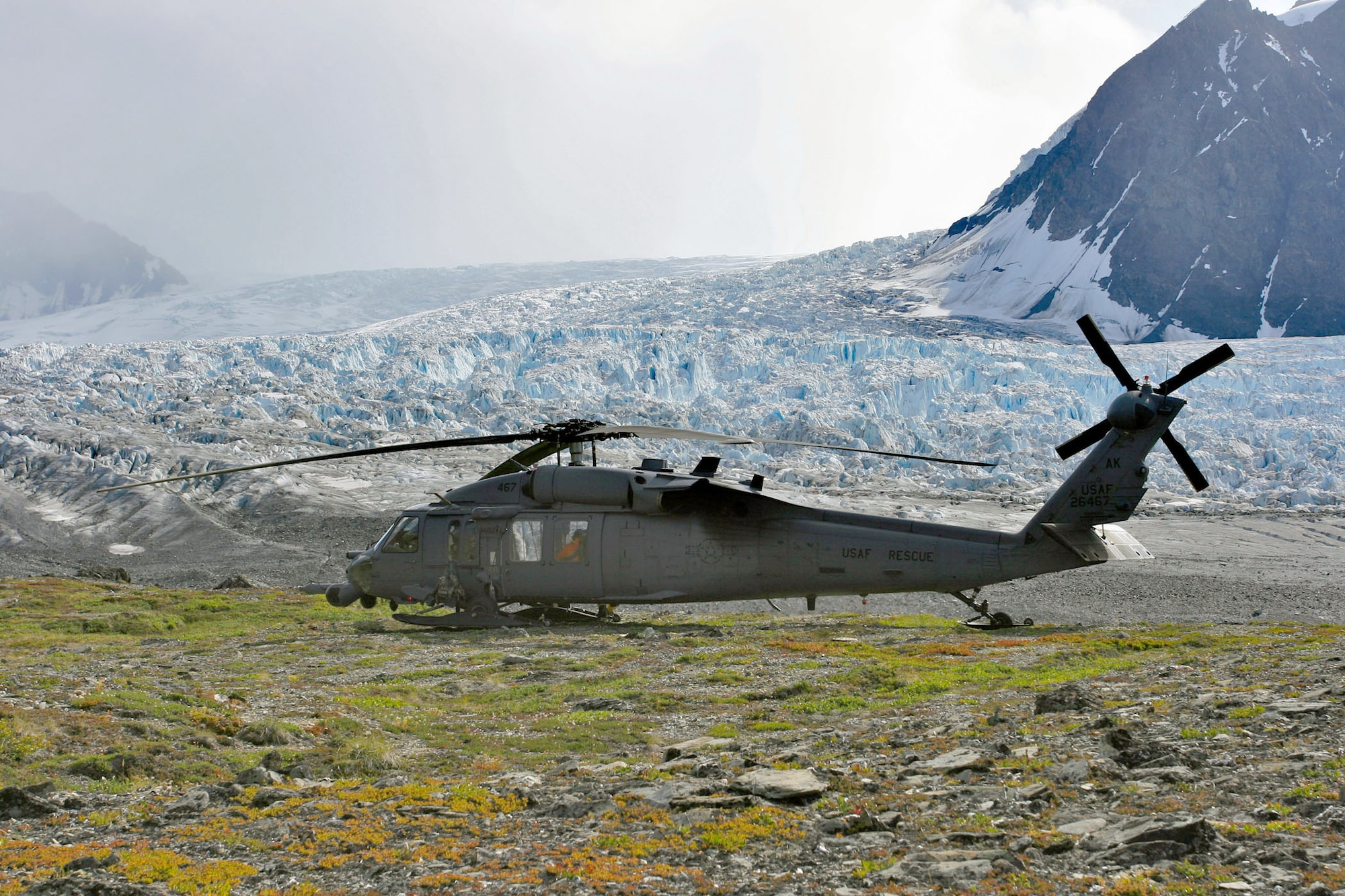 An Alaska Air National Guard HH-60 Pave Hawk waits for the weather to clear before making another attempt to reach the survivors of a plane crash Aug. 8, 2010, five miles from the Knik Glacier crash site. (Alaska National Guard photo/Master Sgt. Sean Mitchell)