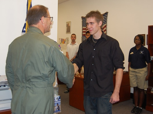 Col. Brunke (left), 926th Group commander, congratulates local Las Vegas resident David Kammler, after administering the Oath of Enlistment during a monthly meeting Aug. 7 at the Craig Road Air Force Reserve Recruiting station. Kammler became part of the Delayed Entry Program, where he enlisted into the Individual Ready Reserve component while awaiting to leave for Basic Military Training. Upon completion of BMT and technical training school, Kammler will serve as an Air Force Reserve vehicle maintenance apprentice with the 555th RED HORSE Squadron here.