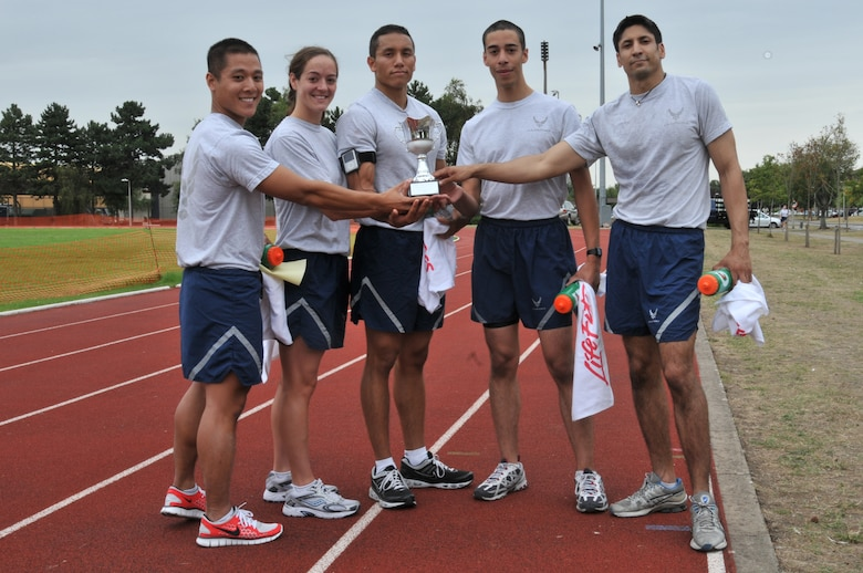 Capt. Thien Nguyen, Staff Sgt. Stacie McHugh, Senior Airman Javier Urteaga, Airman 1st Class Aaron Medina and Staff Sgt. Eric DeSouza of the 48th Medical Group stand with their prize for finishing first in the Commander's Trophy PT Challenge August 6. The team completed the challenge with a time of 57 minutes and 26 seconds. (U.S. Air Force photo/Senior Airman David Dobrydney)