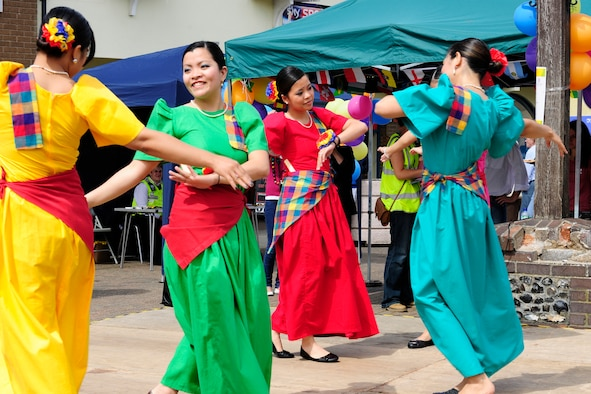 RAFs Lakenheath and Mildenhall's Filipino-American Friendship Club dancers perform at Market Hill in Brandon, England, Aug 7. The Fil-Am has approximately 150 military members, not including dependants. (U.S. Air Force photo/Airman 1st Class Tiffany Deuel)