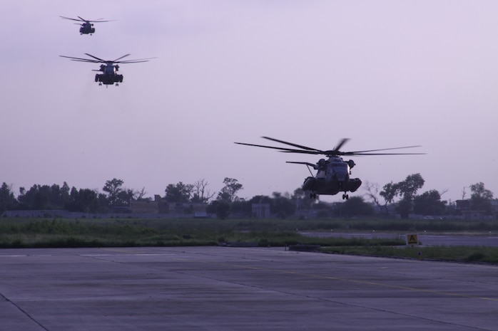 U.S. Marine Super Stallions (CH-53E) helicopters from HMM-165 REIN, 15th Marine Expeditionary Unit land at Ghazi Air Base, Pakistan as a part of the humanitarian assistance relief efforts in Pakistan, Khyber Pakhtunkhwa province (formerly North West Frontier province), Pakistan, Aug. 13, 2010.
