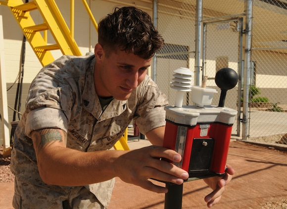 Cpl. Bryan Weingart, station weather observer, examines readings from a thermal environment monitor to determine the wet-bulb globe temperature index at the Marine Corps Air Station in Yuma, Ariz., Aug. 13, 2010. Weingart and 11 other meteorological and oceanographic Marines will be transferring from Marine Wing Support Squadron 371 to Marine Air Control Squadron 1's Detachment C as part of a Corpswide move to better align METOC Marines with air traffic control squadrons.