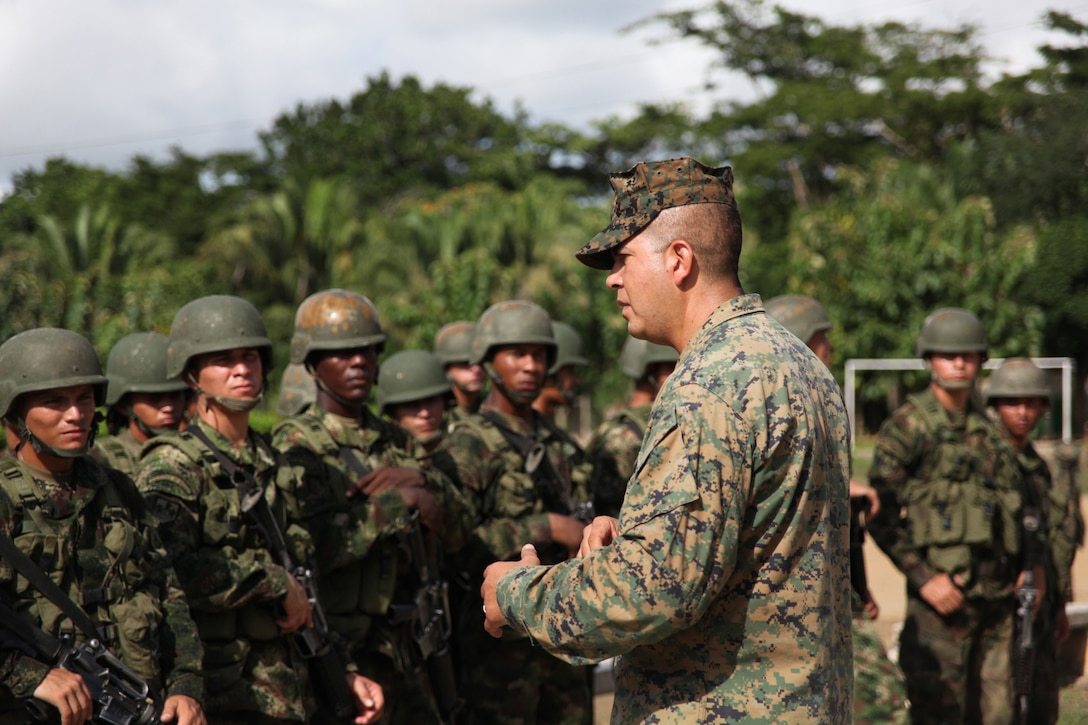 Staff Sgt. Gabriel Delarosa, native of Holland, Mich., and section leader of Company A, 2nd Assault Amphibian Battalion, Ground Combat Element of Special-Purpose Marine Air-Ground Task Force Continuing Promise 2010, gives a class to Colombian Marines about non-lethal weapons tactics at Colombian Marine Corps Training Base Covenas in Colombia, Aug. 14, 2010. Marines from USS Iwo Jima conducted subject matter expert exchanges with Colombian Marines Aug. 9-17 in support of Operation Continuing Promise 2010.