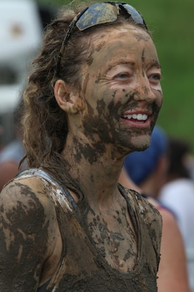Jessi Cisewski, a graduate student from Chapel Hill, N.C., takes a break after finishing Run Amuck Aug. 14, 2010, at Marine Corps Base Quantico, Va. Cisewski ran with several of her friends from college, and said she enjoyed pushing them over in the mud pit.