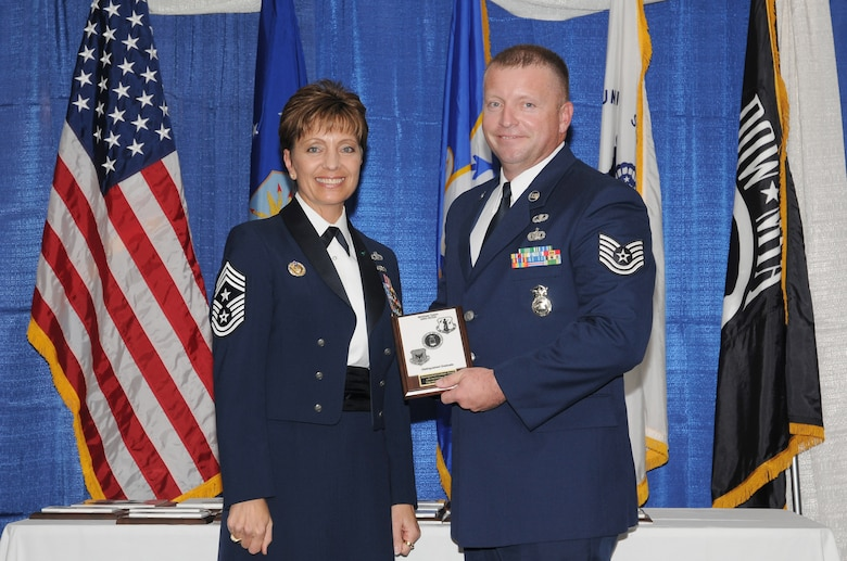 McGHEE TYSON AIR NATIONAL GUARD BASE, Tenn. -- Tech. Sgt. Michael W. Parson, right, receives the distinguished graduate award for NCO Academy Class 10-7 at The I.G. Brown Air National Guard Training and Education Center here from Chief Master Sgt. Denise Jelinski-Hall, Aug. 12, 2010.  The distinguished graduate award is presented to students in the top ten percent of the class.  It is based on objective and performance evaluations, demonstrated leadership, and performance as a team player. (U.S. Air Force photo by Master Sgt. Kurt Skoglund/Released)