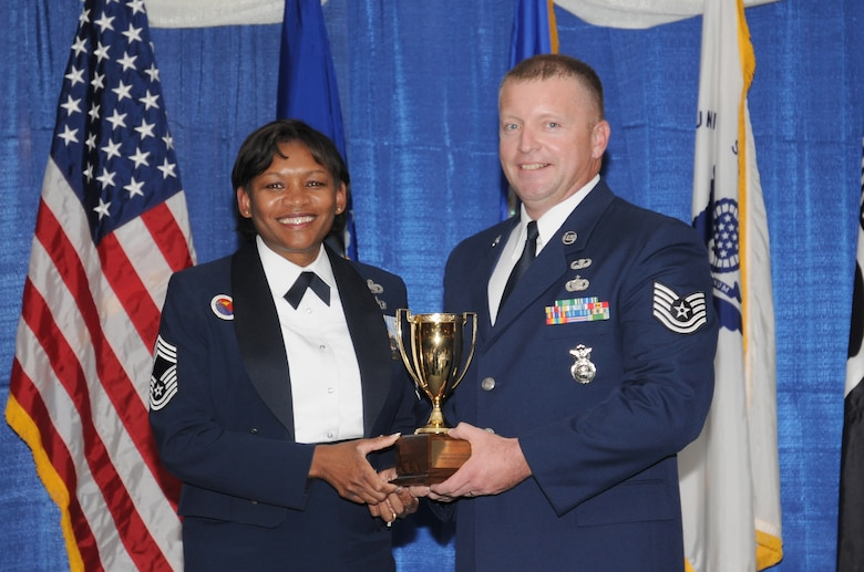 McGHEE TYSON AIR NATIONAL GUARD BASE, Tenn. -- Tech. Sgt. Michael W. Parson, right, receives the Paul H. Lankford leadership award for NCO Academy Class 10-7 at The I.G. Brown Air National Guard Training and Education Center here from Chief Master Sgt. Deborah F. Davidson, EPME commandant, Aug. 12, 2010. The leadership award is presented to the student who made the most significant contribution to the overall success of the class by demonstrating superior leadership abilities and excellent skills as a team member.  It is named in honor of CMSgt Paul H. Lankford, a Bataan Death March survivor and the first commandant of the Air National Guard Enlisted Professional Military Education Center.  (U.S. Air Force photo by Master Sgt. Kurt Skoglund/Released)