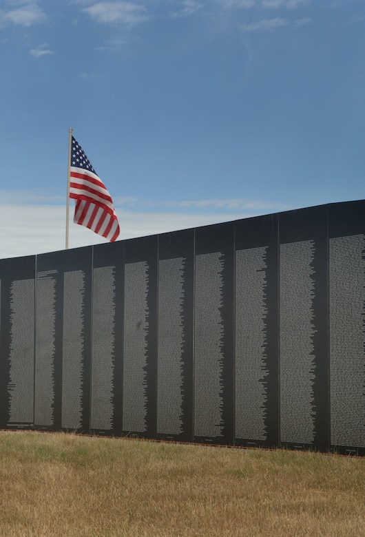 ELLSWORTH AIR FORCE, S.D. – The traveling wall stands for the first time at the Buffalo Chip, Sturgis, S.D.  The wall is 80 percent the size of the original Vietnam Memorial Wall in Washington, D.C. and includes all of the names of the original.  (U.S. Air Force photo/Airman 1st Class Alessandra N. Hurley)