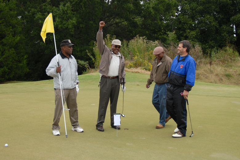 Participants celebrate at last years golf tournament.