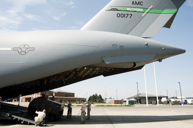 U.S. Air Force Airmen load cargo onboard a C-17 Globemaster III during Aerial Port Expeditor training Aug. 17 at Joint Base Lewis-McChord, Wash. (U.S. Air Force photo/Abner Guzman)