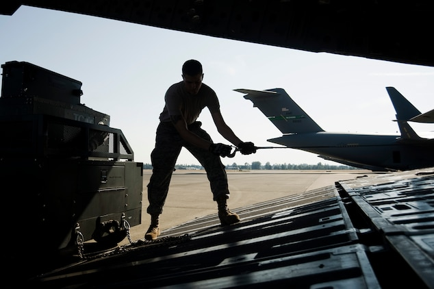 Senior Airman Jeremy Schmid, 62nd Aerial Port Squadron, loads cargo while undergoing Aerial Port Expeditor training Aug. 17 at Joint Base Lewis-McChord, Wash. (U.S. Air Force photo/Abner Guzman)