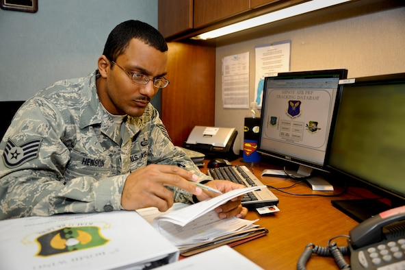 MINOT AIR FORCE BASE, N.D. -- Staff Sgt. Eric Henson, 5th Force Support Squadron base personnel reliability program monitor, inputs information into the Minot AFB PRP tracking database here Aug. 16. Minot is home to the largest PRP program in the Defense Department and home to the only dual-wing, nuclear base in the Air Force. (U.S. Air Force photo by Senior Airman Benjamin Stratton)