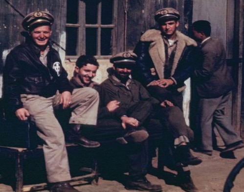 """China National Aviation Corporation (CNAC) cargo crews wore a variety of uniform items. Capt. Steve Kusak (left) is wearing the typical flight uniform of khaki shirt and pants, Wellington boots, USAAF A-2 leather flight jacket with """"Chung,"""" and CNAC uniform hat. The others are using USAAF A-4 flight suits over their uniforms with a B-3 flight jacket being worn on the right. (Photo courtesy of cnac.org)"""