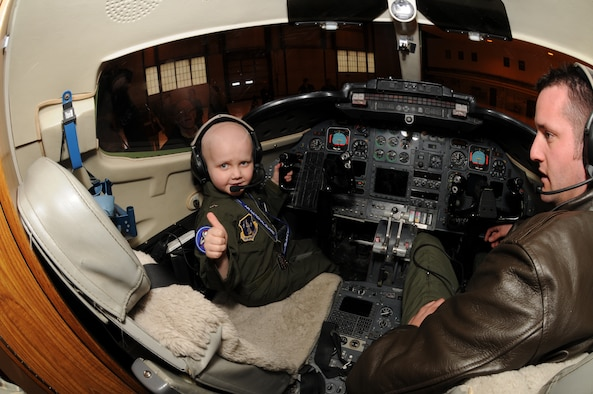 Jordan Dvorak, 5, of Grand Forks, N.D., gives a 'thumbs up' as he sits in the cockpit of the C-21 Lear Jet at the 119th Wing, North Dakota Air National Guard. Dvorak, who was diagnosed with leukemia in August 2009, was the recent special guest for the Happy Hooligan's 'Pilot for a Day' event that took place in March.