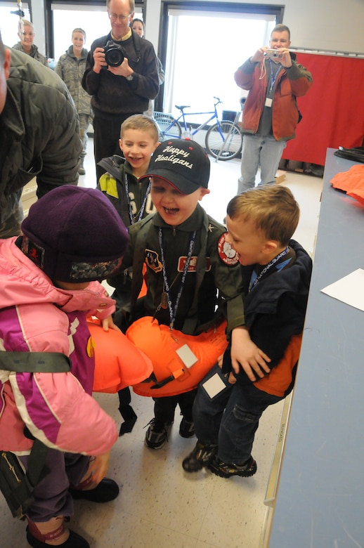 Jordan Dvorak, 5, of Grand Forks, N.D., takes part in a fun hands-on demonstration in the Life Support Shop at the 119th Wing, North Dakota Air National Guard during a base tour.  Dvorak, who was diagnosed with leukemia in August 2009, was the recent special guest for the Happy Hooligan's 'Pilot for a Day' event that took place in March.