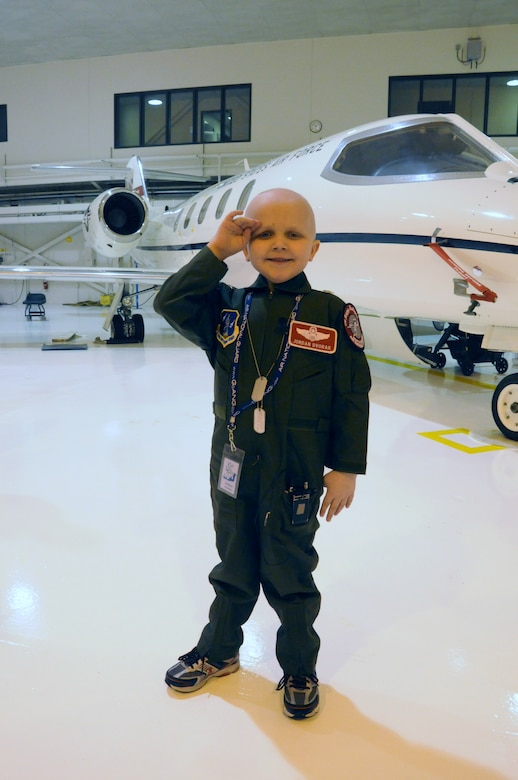 Jordan Dvorak, 5, of Grand Forks, N.D., salutes his family and friends during the 'Pilot for a Day' event that took place at the 119th Wing, North Dakota Air National Guard in March.  Dvorak was diagnosed with leukemia in August 2009.  During his special day he received a flight suit made especially for him and was promoted to the military rank of General.