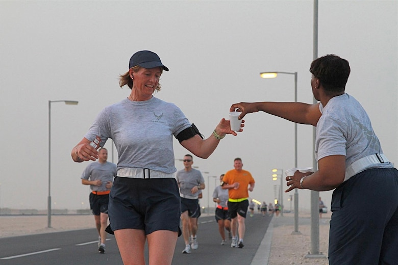 Senior Master Sgt. Deanna Criswell runs a half marathon at Al Udeid Air Base, Qatar. Criswell is the first female Air National Guard fire chief and is currently deployed as the Air Force's Forward Functional Fire Manager.
