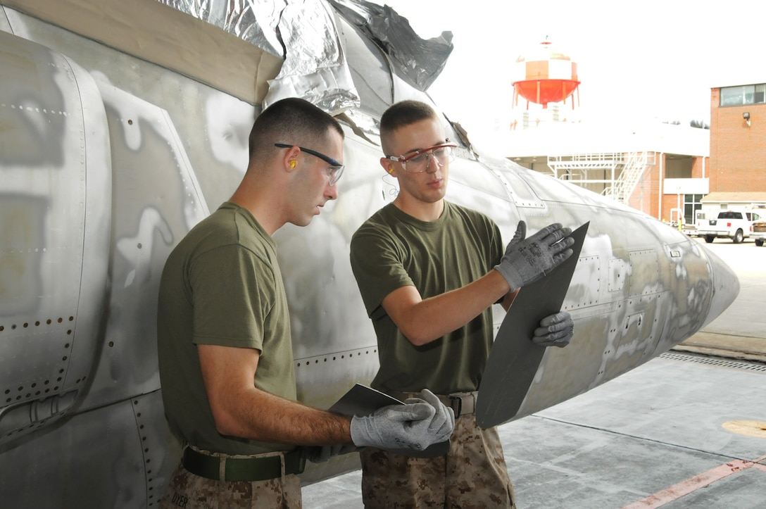 Cpl. Michael D. Dyer and Pfc. Cody J. Mathias work on the refurbishment of an F-11 aircraft at Fleet Readiness Center-East Aug. 11. The aircraft was exhibited in the city of New Bern, N.C., for decades but had become corroded and was disgraced by vandals. Dyer and Mathias are aircraft intermediate level structures mechanics with Marine Aviation Logistics Squadron 14.