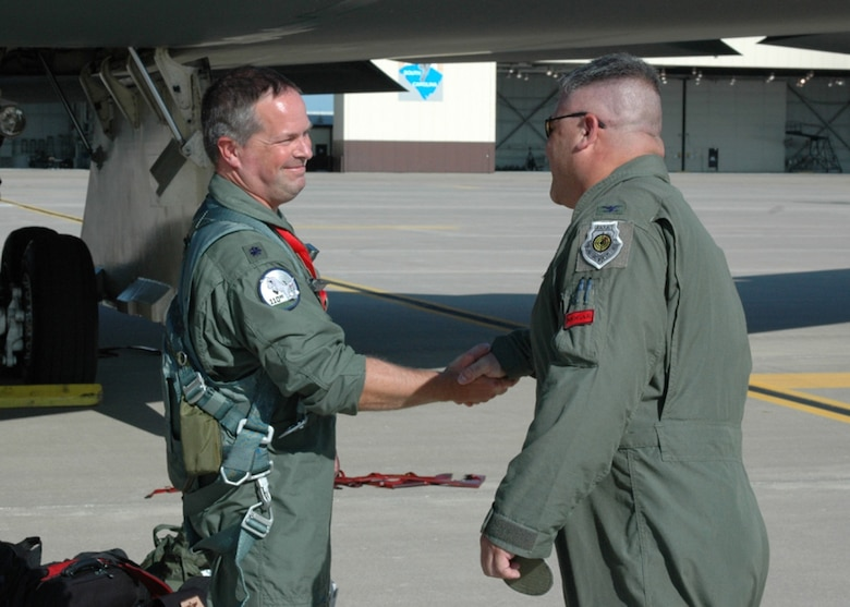 "Lt. Col. Ken ""Willie B"" Eaves, 131st Operations Group commander, congratulates Lt. Col. Michael ""Farmer"" Pyburn on accomplishing 1000 B-2 flying hours at Whiteman AFB, Mo, August 15.  Pyburn joins an elite group of 131st Bomb Wing Missouri Air National Guard B-2 pilots: Lt. Col. Michael Means who achieved this milestone almost three years ago while on active duty; Lt. Col. Rhett Binger, June 2009;     Maj. Jared Kennish, Oct.2009; and  Maj. John Avery, March 2010.  (Air Force Photo by Technical Sgt. Chris Boehlein. RELEASED)"