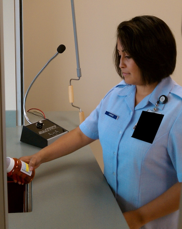 Senior Airman Diana Vargas, 460th Medical Group, prepares for the opening of the new pharmacy located next to the Commissary Aug. 16. The pharmacy will open Sept. 7 and features two drive-through windows for prescription refills. (U.S. Air Force photo by Master Sgt. Larry Boyce)