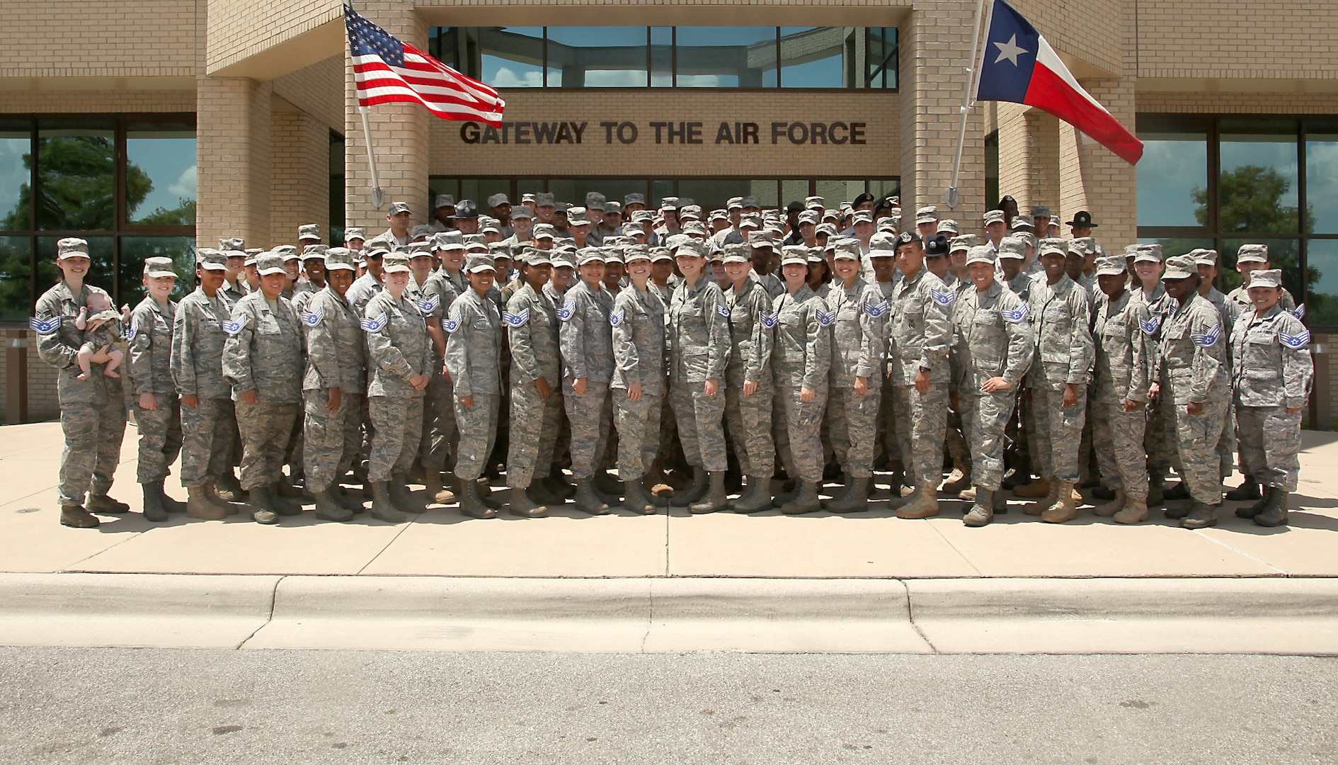 Lackland Airmen selected for promotion to staff sergeant gather for a group photo Aug. 19. (U.S. Air Force photo/Robbin Cresswell)