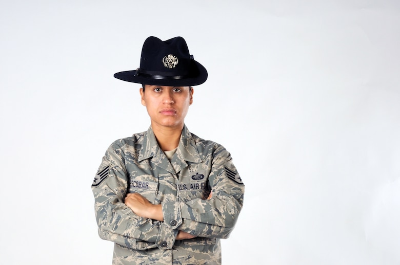 Staff Sgt. Maria Escobar poses for a photo in the 102nd Intelligence Wing's public affairs office on 8 Aug. 2010. Sergeant Escobar, a 102nd Force Support Squadron personnell specialist, recently became a Military Training Instructor and is bound for Lackland AFB, Texas.