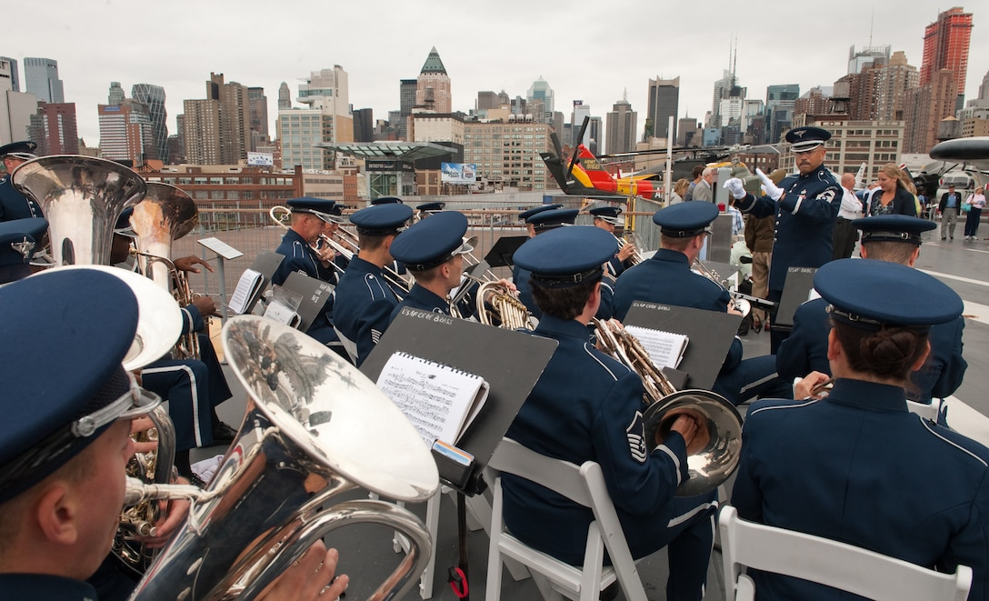 "The Air Force Band performed during the Air Force Week New York City proclamation ceremony at the USS Intrepid on Aug. 24, 2010. The event at the Intrepid Sea, Air & Space Museum was highlighted by a six-ship flyover by the USAF Thunderbirds. The Honorable Michael Donley, Secretary of the Air Force attended, along with General Raymond Johns, Commander of Air Mobility Command. The Police Commissioner of the City of New York, the Honorable Raymond Kelly, represented NYC. Mr. Greg Kelly of ""Good Day New York"" was emcee for this event. (U.S. Air Force photo/Lance Cheung)"