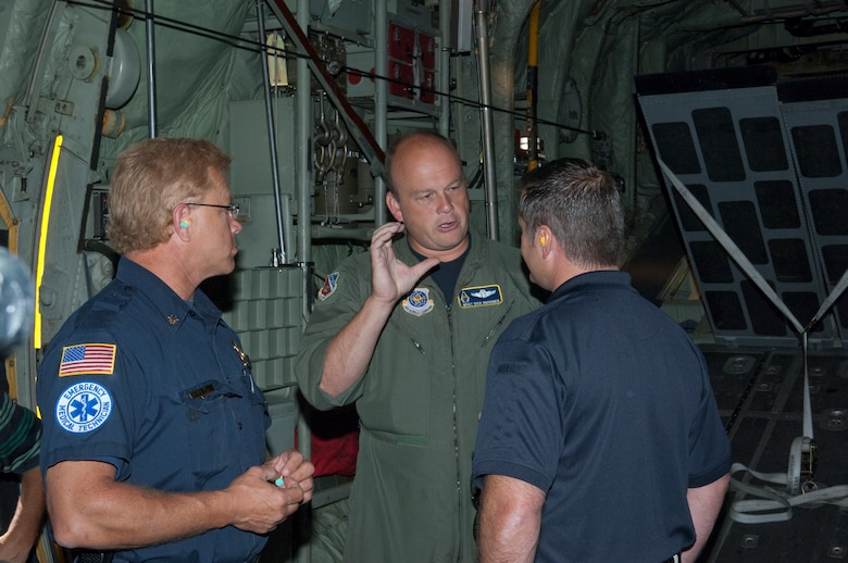 "Metropolitan Twin Cities civilian officials talk with an Airman aboard a C-130 ""Hercules"" as they participate in Metro Mayors Day at the 133rd Airlift Wing on August 19, 2010. The Minnesota National Guard units at the Minneapolis-St. Paul International Airport brought local officials on base and on a flight on a military cargo aircraft to demonstrate the capabilities that could be available once authorized for communities. USAF Official Photo by Senior Master Sgt. Mark Moss"