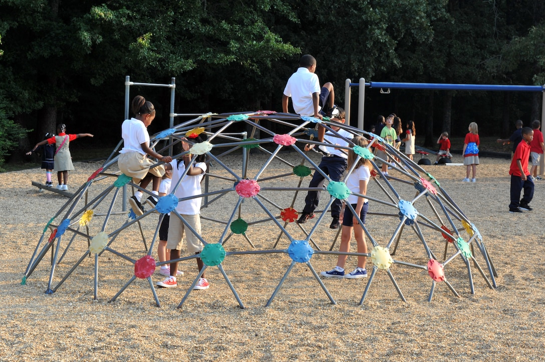 Children play on the playground at Arnold Drive Elementary School Aug. 19 before the first day of school begins. Arnold Drive has changed the time the school day begins to allow the children to have more time to play together and eat breakfast. (U.S. Air Force photo by Staff Sgt. Chris Willis)